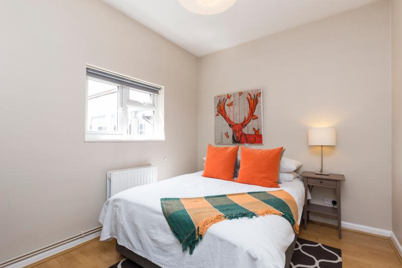 Bedroom with King-size bed, deluxe white sheets and extra comfortable duvet  and storage wardrobe