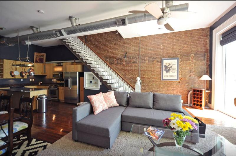 150yr Old Exposed Brick, Wood Floors, Hand carved Staircase