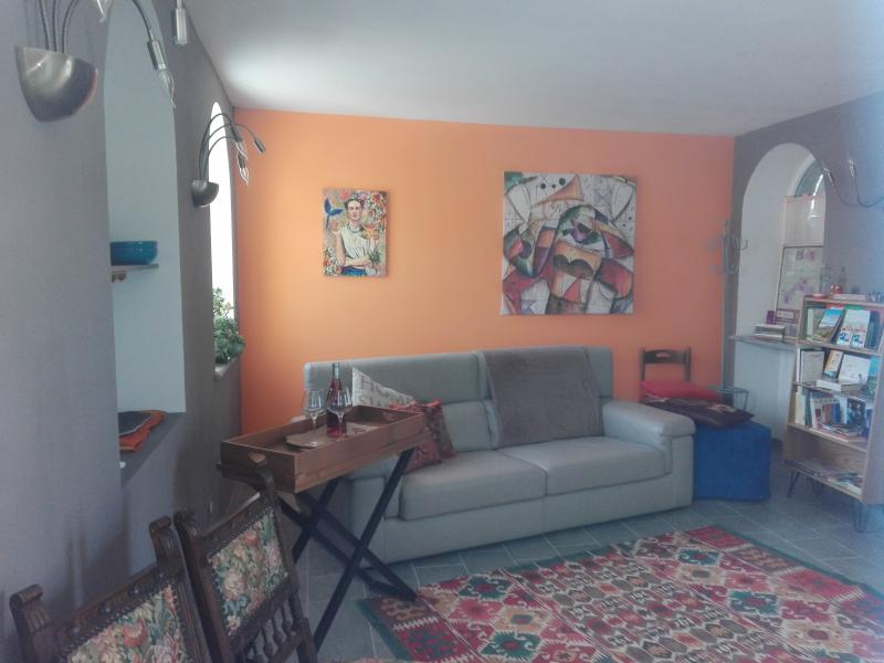 Lounge room with a wood fireplace, leather sofa, tasting corner, satellite TV