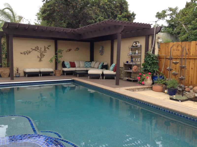 Salt water solar heated pool w/ automatic safety pool cover. Comfortable seating.