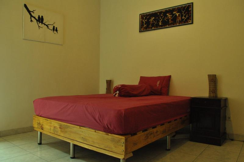 queen bedroom with our personal touch (we made the bed platform ourselves)