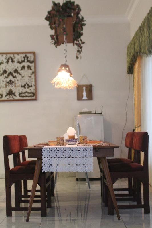 the dining table seen from the kitchen side