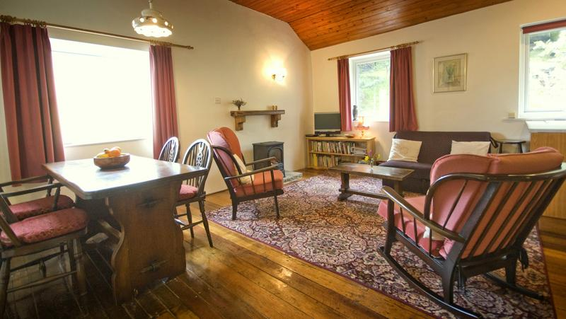 Warm comfortable barn cottage with a quiet outlook over the woodland garden.