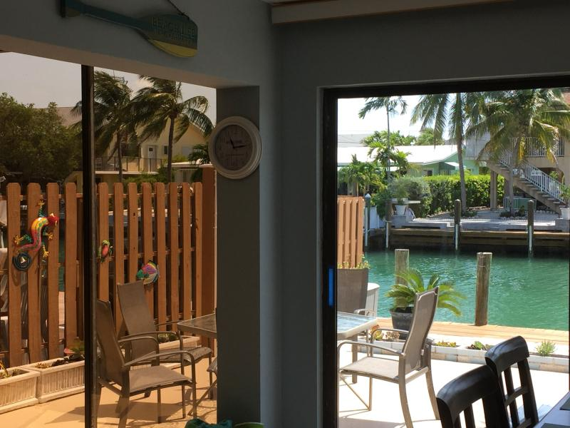 Looking out to Canal from Kitchen  Sliding Doors in Dining Area and in Living Room.