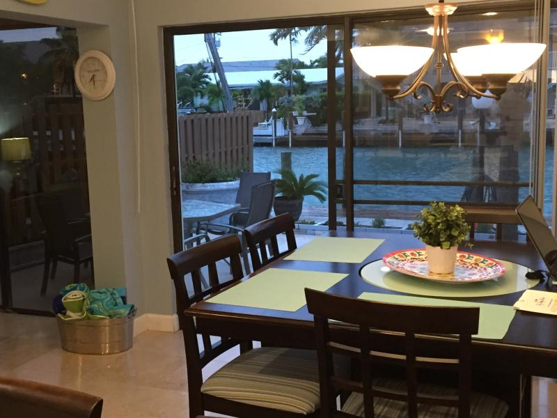Looking out from Dining room to patio and canal
