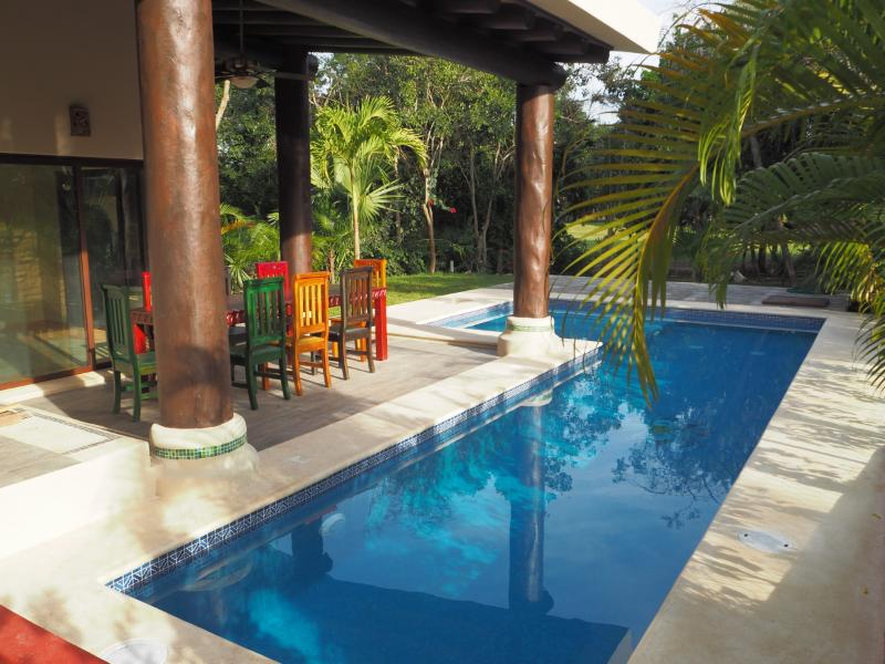 Swimming pool with outside seating area