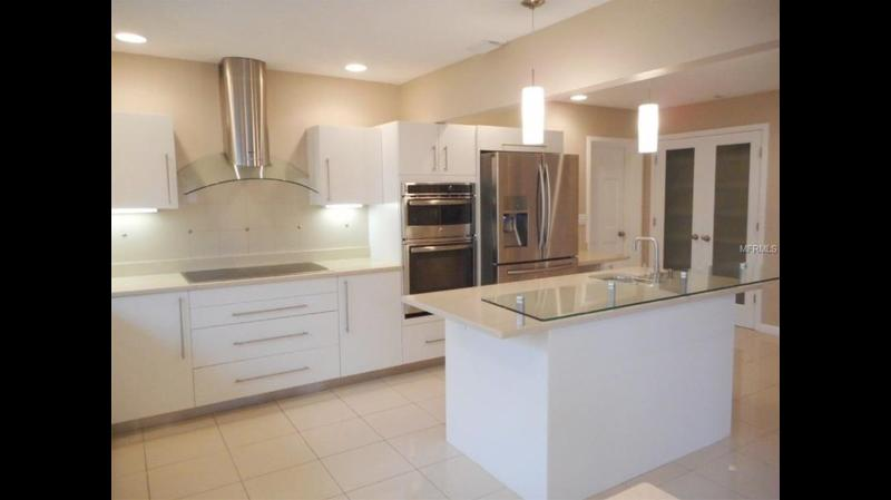 Updated Kitchen with dual stove stove and stainless appliances