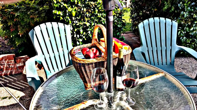 Patio Table, Chair and Gift Basket in Backyard