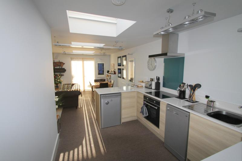 Fully equipped modern kitchen, oven, induction hob, extractor fan, microwave, slow cooker, fridge.