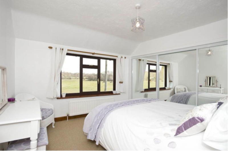 Master bedroom with king-size bed and fabulous views over the New Forest