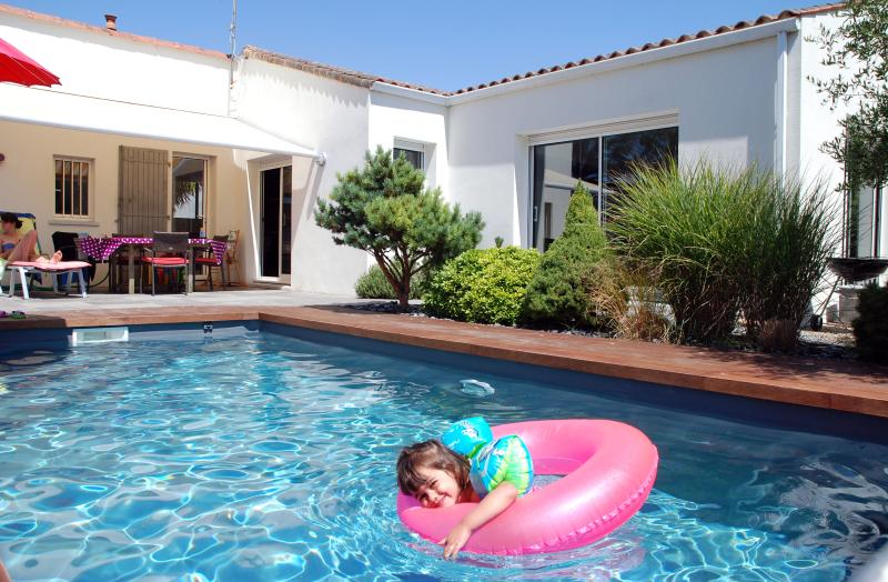 Large house with secure pool, ideal for families.