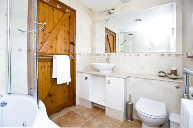 Luxury family bathroom with drencher shower and Jacuzzi bath to relax those aching muscles!