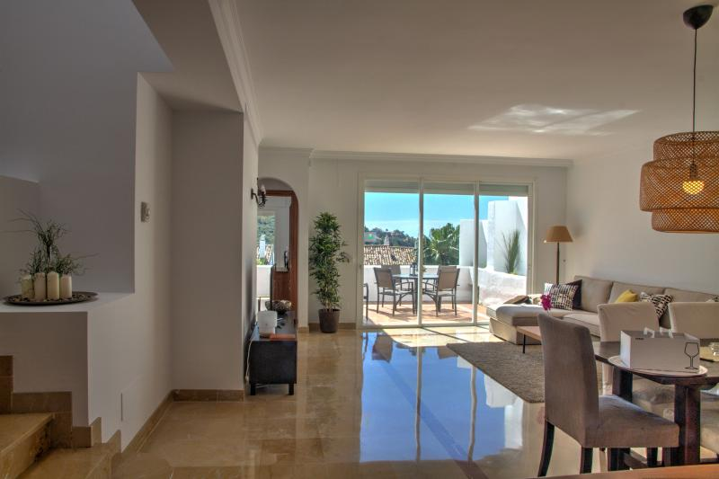 Ample and bright living room with terrace and views