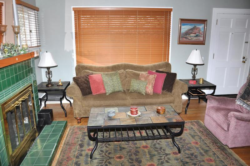Relax on the antique camelback sofa and gaze out the huge picture window.