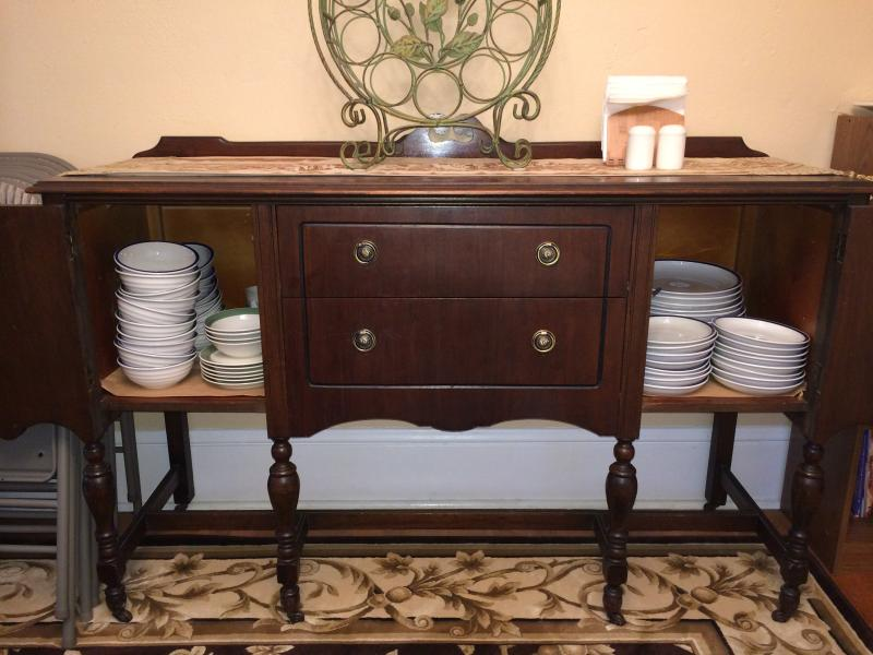 Antique sideboard with many place settings