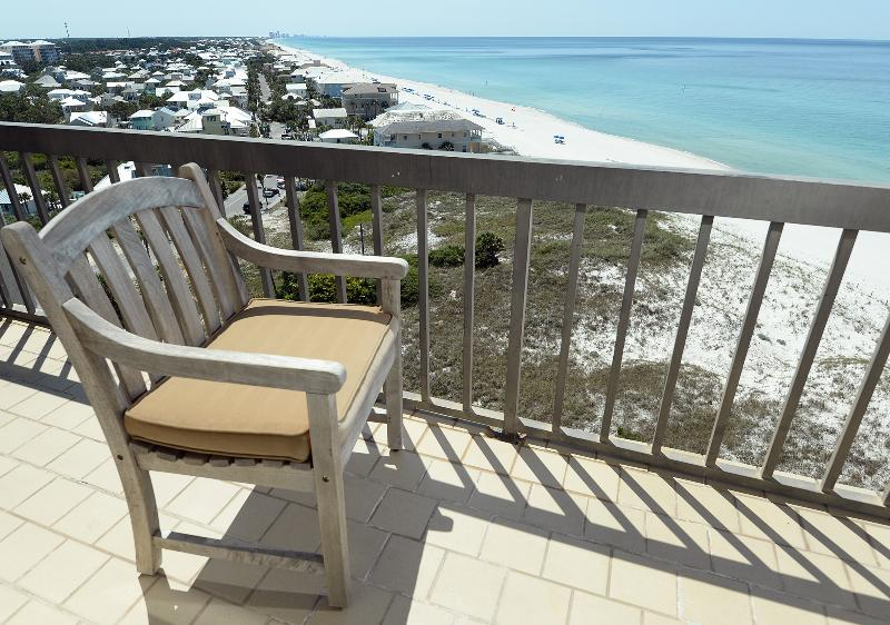 Gulf-front balcony with premium teak furniture seating for 4