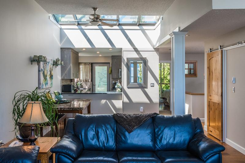 Skylight, illuminates this beautiful open dining room, pass through to the kitchen and then to deck.