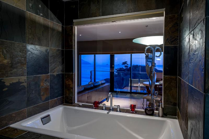 Soaking tub. Bathroom also has a large slate, glass enclosed shower stall