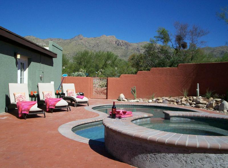 Pool and spa enclosed within walls; mountain views.
