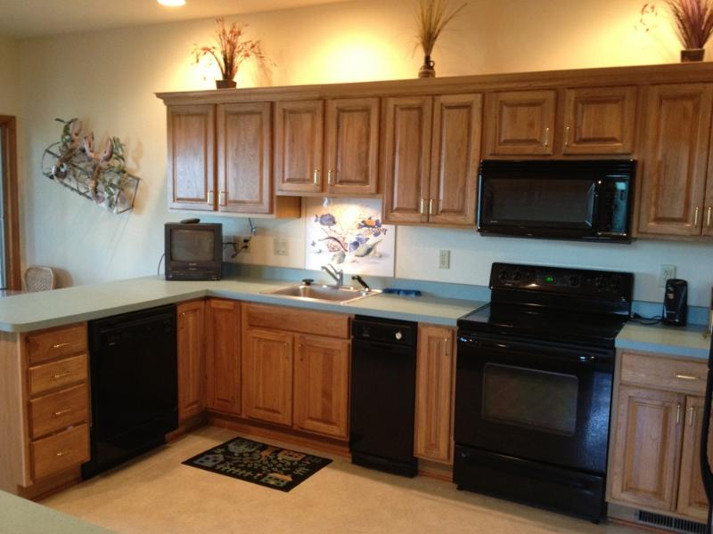Full kitchen.  Dishwasher, stove, microwave, coffee maker, dishes, silverware