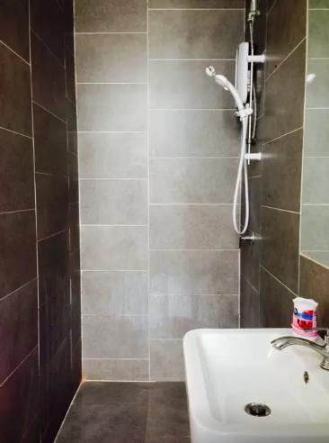 Simple, monotonous and clean showering area will give the refreshing environment you need