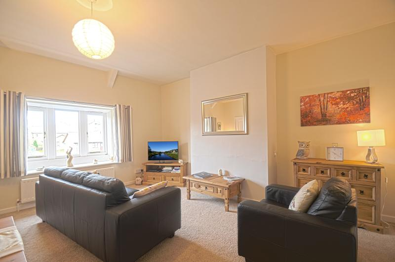 The bright and spacious Living Room has beautiful views of the Simonside Hills