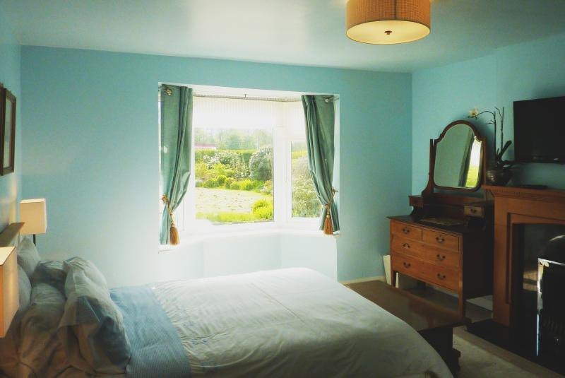 Greenfields Annex Double bed with bay window overlooking the front garden