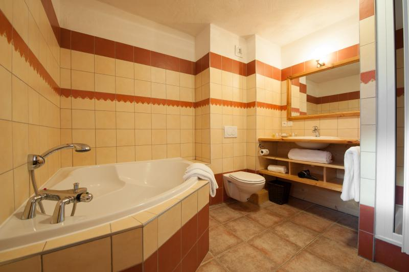 Three of the twin bedrooms in the chalet have ensuite bathrooms