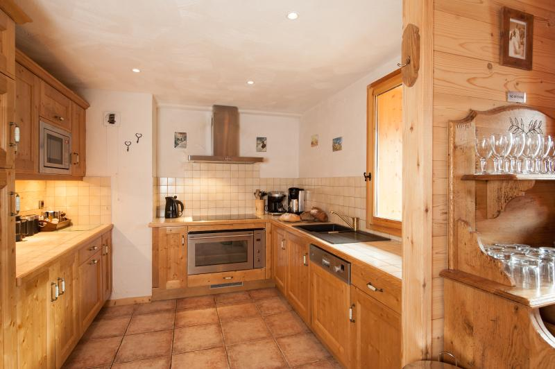 The fully equipped kitchen is complete with dishwasher, is just off the main living & dining area