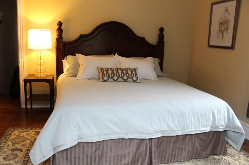 King bed with fine linens