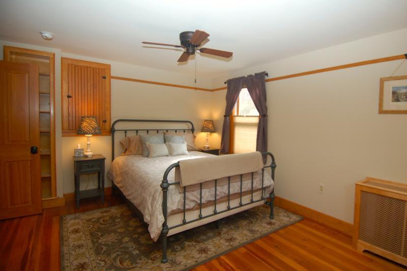 Second Bedroom with Queen Bed, Hardwood Floors, & Wool Area Rug