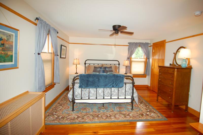 Master Bedroom with Queen Bed, Hardwood Floors, & Wool Area Rug