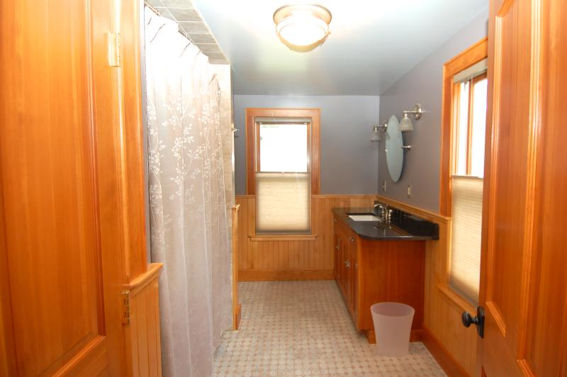 Master en suite Bathroom with Tile Floor and Tub Surround, Custom Cabinetry, Granite Counter Top