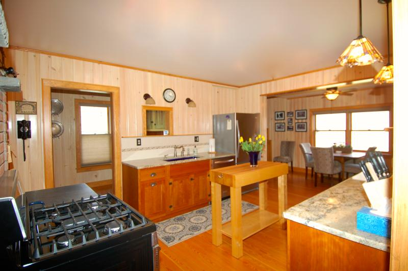 Large Country Kitchen with Wood Floors, Maple Butcher Block, Granite Counter Tops, Custom Cabinetry
