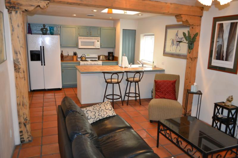 Kitchen is full equipped with three bar stools