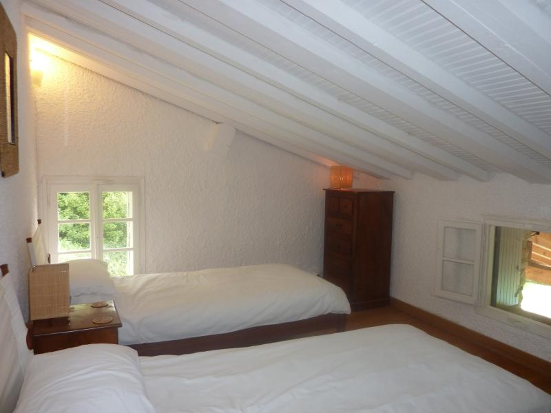 Twin bedroom above dining room.