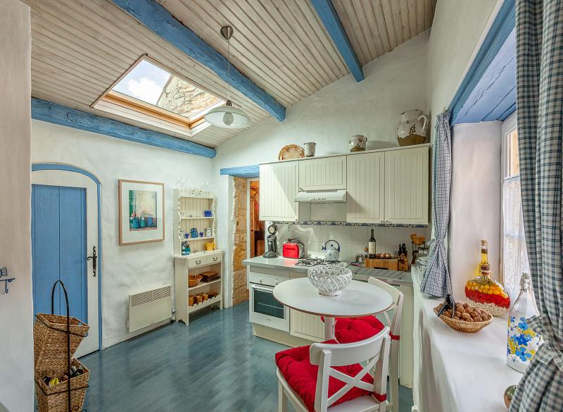 Bright and airy kitchen with a wonderful sky light and beautiful painted floors