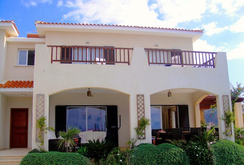 Front of villa with balcony and out side seating area