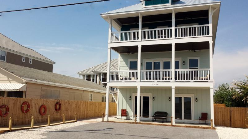 Front view-- 3 oversized decks, ample parking for up to 9 cars plus secure motorcycle parking.