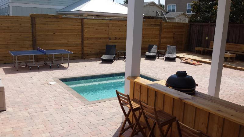 The perfect backyard! Spacious enough for snacking, splashing, sports & sunning!