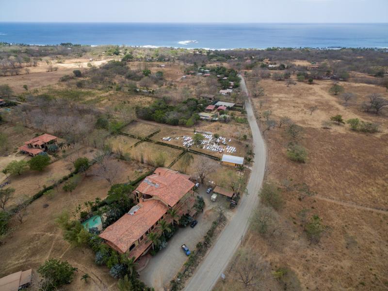 Drone view of Plaza Tierra Pacifica toward Playa Junquillal
