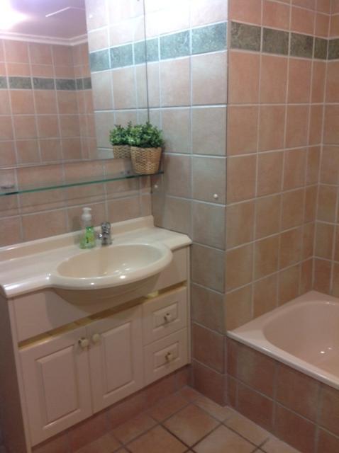 Main bathroom has shower and full size bath.