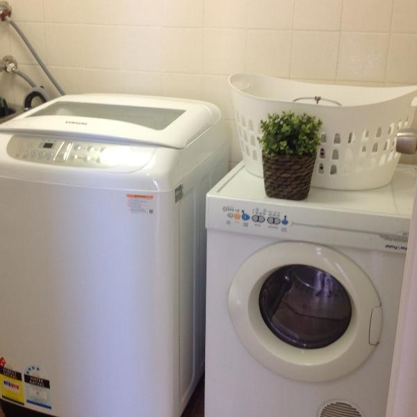 Washing machine and dryer in separate laundry area.