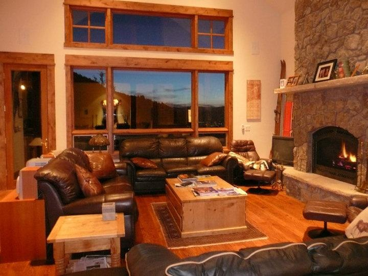 Great Room has Stunning Sunset views and Fireplace Warmth; Seats 15+; 20 ft ceilings; Deck/gas grill
