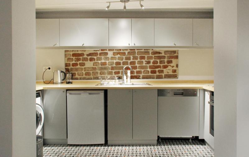 Full kitchen with owen, fridge, dishwasher, washer and dryer