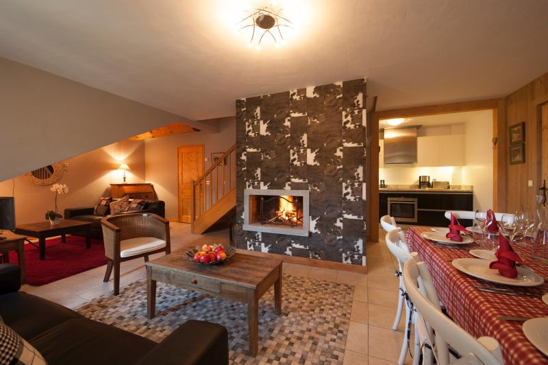 The cow hide pattern chimney breast is a real focus in the combined living & dining area