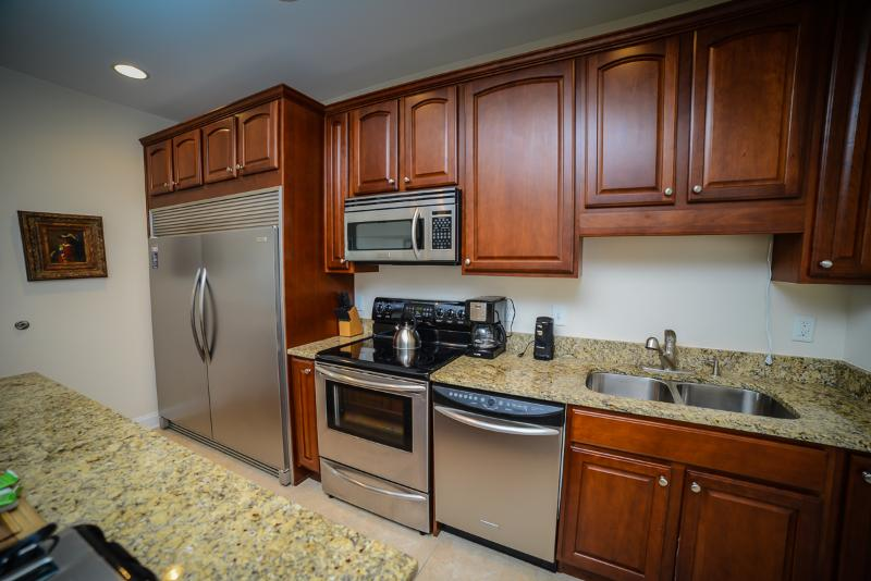 Stainless steel appliances and granite counters in kitchen
