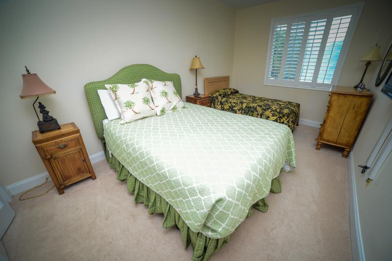 Queen and twin beds in second bedroom