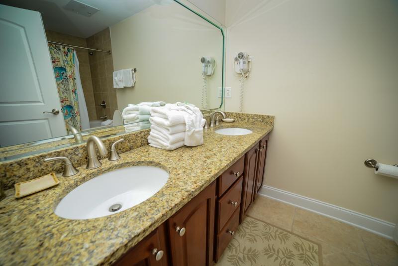 His/hers sinks in master bathroom