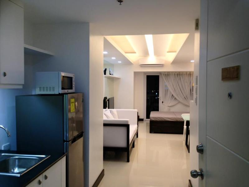 Entrance to the Condo Unit. The space is wide at 41.71 square meters Floor Area. Good up to 4 person